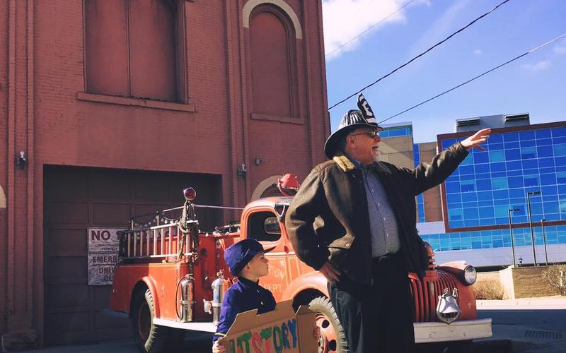 Saint Paul historian Jim Sazevich and young helper address in 2016 a community gathering to protest the threatened demolition of Hope Engine Co. No. 3, the city's oldest municipal building, constructed in 1872.