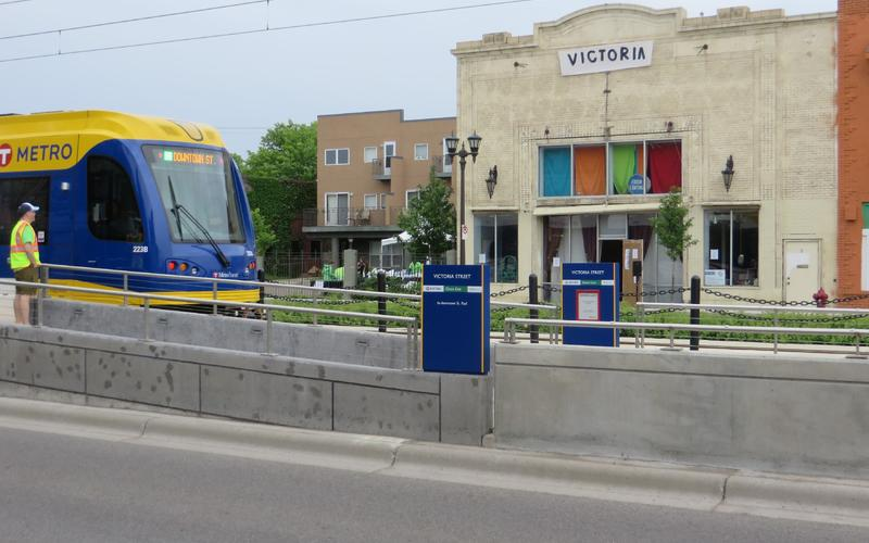 The Green Line light rail approaching the Victoria Theater