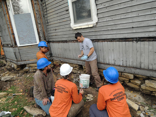 The Northwest Bedrock Historic Preservation Corps working on the preservation of 767 E 4th.